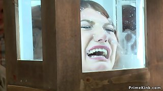 Shackled redhead is toyed in public