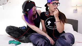 Naughty gamer girls Kira Burn and Mia Luna lick unendingly other