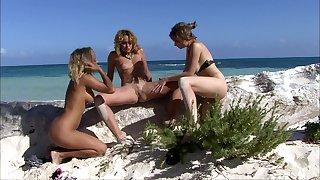 Hot lesbian Tarra White enjoys a triplet at hand strangers on the beach
